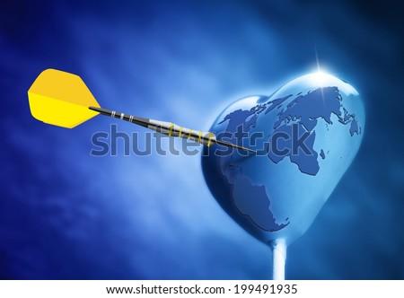 Heart shaped on earth lollipop hit by an arrow - stock photo