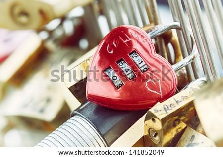 Heart shaped padlock at love bridge in Paris, France - stock photo