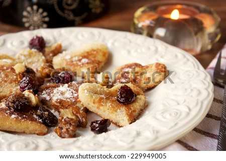 Heart-shaped Pancakes with caramelized walnuts and dried cranberries - stock photo