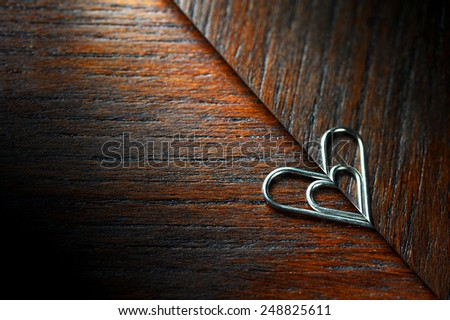 Heart shaped paper clip with reflex - stock photo