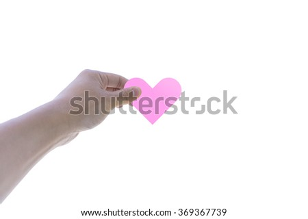 Heart shaped paper on man hand holding; isolated on white background