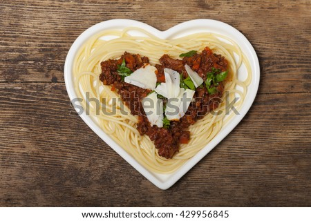 heart shaped pasta dish  - stock photo