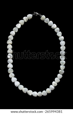 Heart shaped peal necklace isolated over black - stock photo
