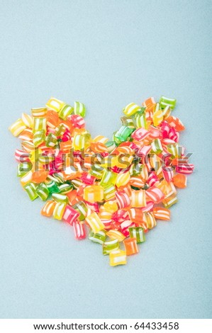 heart shaped pile of colorful candies - stock photo