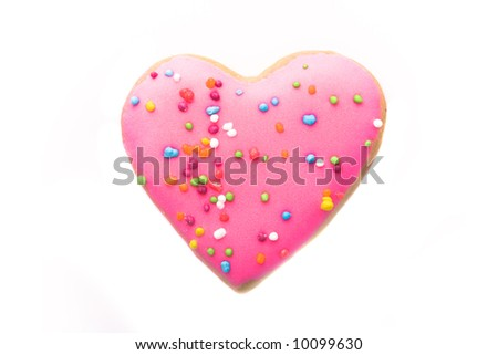 Heart shaped pink cookie isolated on white - stock photo