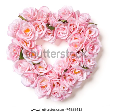 Heart Shaped Pink Rose Arrangement on a White Background. - stock photo
