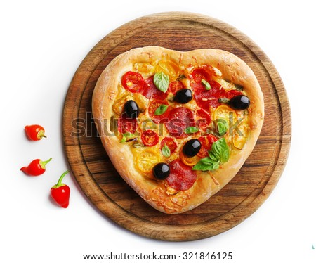 Heart shaped pizza on cutting board isolated on white