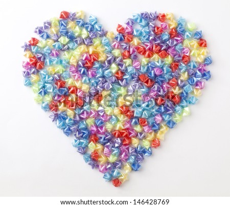 Heart-shaped plastic stars on a white background