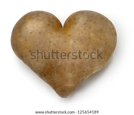 Heart shaped Potato on a white background. - stock photo