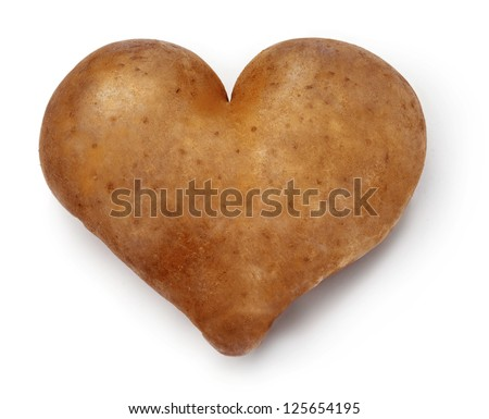 Heart shaped Potato on a white background. Saturated colors. - stock photo