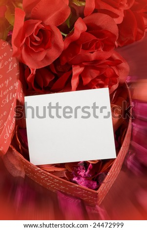 Heart shaped red box with white note in it