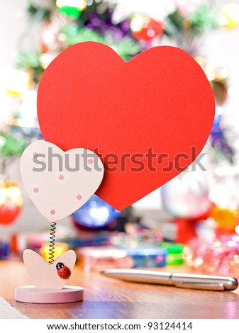 heart-shaped red paper on holder for valentines day note - stock photo
