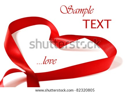 Heart shaped red satin ribbon on white background with copy space.  Macro with shallow dof. - stock photo