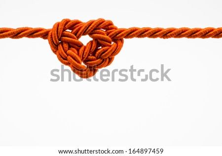 Heart shaped rope on white background