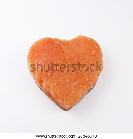 heart shaped salmon fillet on a white background