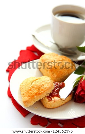 Heart shaped scones with strawberry jam and a cup of tea - stock photo