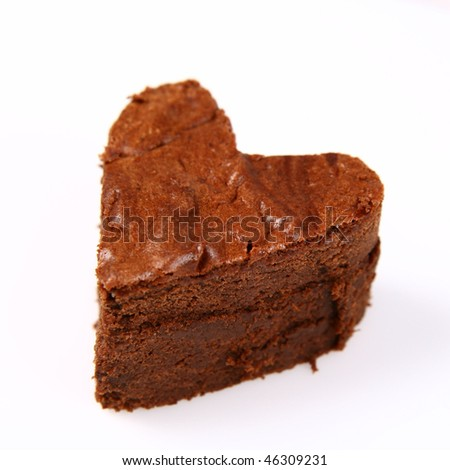 Heart shaped slice of a brownie on white background - stock photo