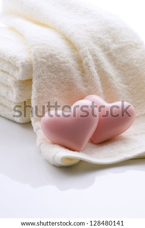 Heart-shaped soap and towels