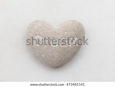 heart shaped stone with text message dream