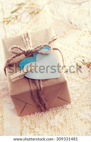 Heart-shaped tags and hand crafted present box  - stock photo