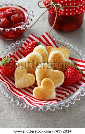Heart shaped toast with fresh strawberry - stock photo