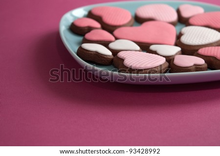 Heart shaped valentine cookies on plate - stock photo