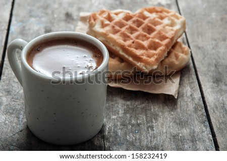 heart shaped waffles and coffee on table,  Shallow dof. - stock photo