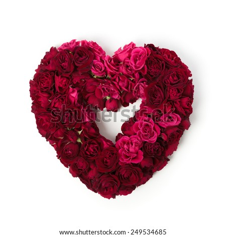Heart shaped wreath made of red an pink miniatures roses isolated on white. - stock photo