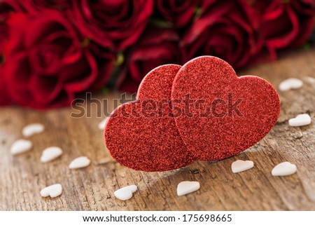 heart shapes with red roses on wood - stock photo