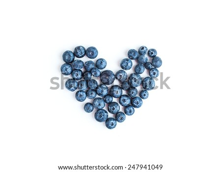 Heart sign made of fresh blueberries on a white background, top view - stock photo