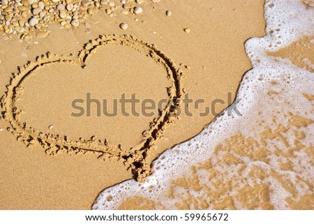 Heart sign on beach. Element of design. - stock photo