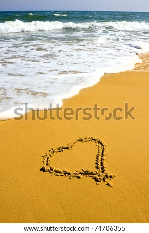 heart sign on sea beach - stock photo