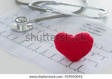Heart ,stethoscope on cardiogram report of cardiology patient.   Cardiologist and medical concept - stock photo