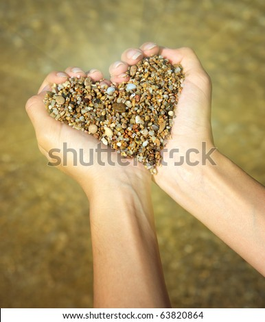 Heart symbol in feminine hand. Conceptual design. - stock photo