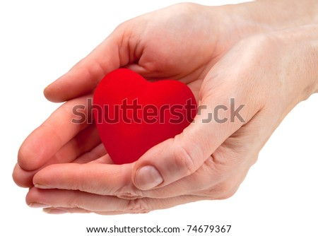 Heart symbol in woman hands isolated on white - stock photo