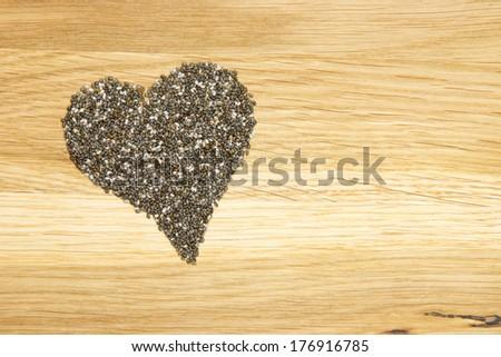 heart symbol made of black chia seeds - stock photo