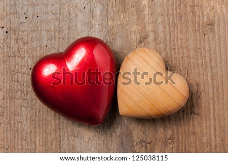 Heart symbol on wooden background