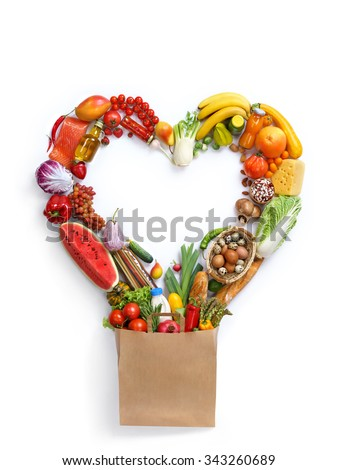Heart symbol / studio photography of heart made from different fruits and vegetables - on white background. Healthy food background, top view. High resolution product, - stock photo