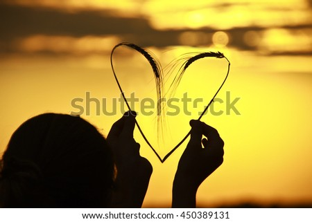 heart symbol with spike of wheat - stock photo