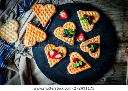 Heart waffles with berries - stock photo