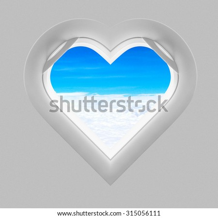 Heart window plane and sky view - stock photo