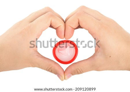 heart with a condom - stock photo