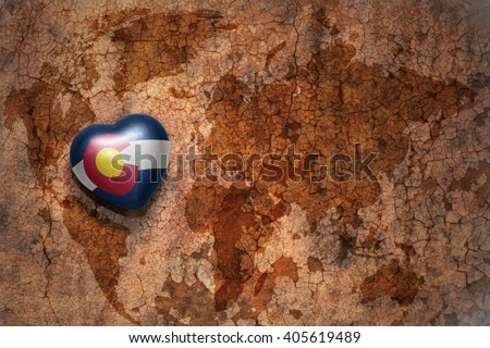 heart with colorado state flag  on a vintage world map crack paper background. concept - stock photo