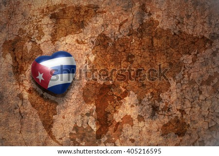 heart with national flag of cuba on a vintage world map crack paper background. concept - stock photo