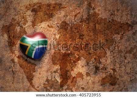 heart with national flag of south africa on a vintage world map crack paper background. concept - stock photo