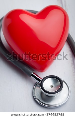 Heart with Stethoscope on a white surface - stock photo
