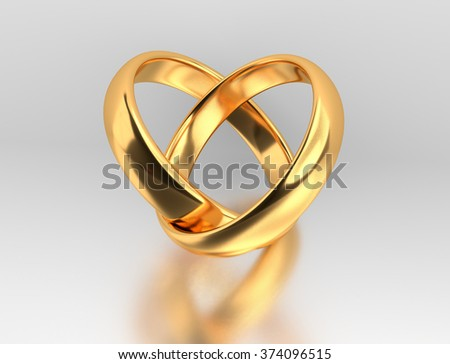 Heart with two connected gold wedding rings with reflection