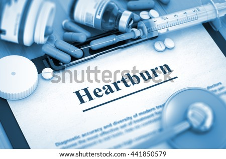 Heartburn - Printed Diagnosis with Blurred Text. Heartburn, Medical Concept with Pills, Injections and Syringe. 3D Render. - stock photo