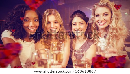 Hearts against portrait of girls holding champagne flute