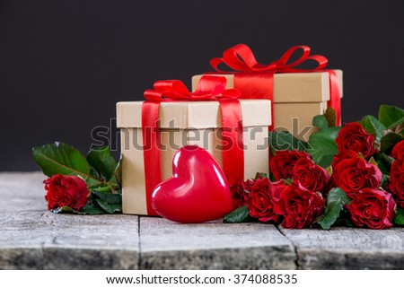 hearts and a bouquet of red roses on wooden board, Valentines Day background - stock photo